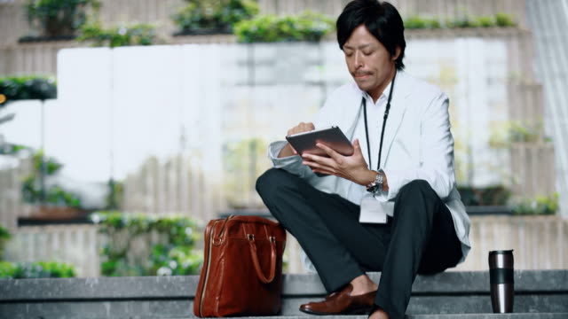 DS Japanese businessman using a digital tablet video