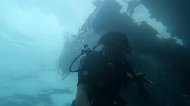 Japanese diver Japanese man enjoy diving to take selfie shoot jp201806 stock videos & royalty-free footage