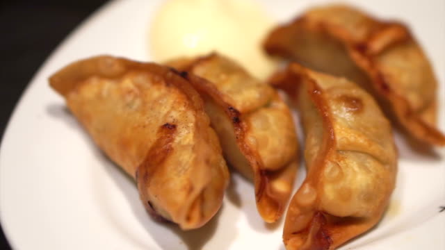 Japanese dumpling, Deep fried Gyoza eating with mayonnaise with chopsticks video