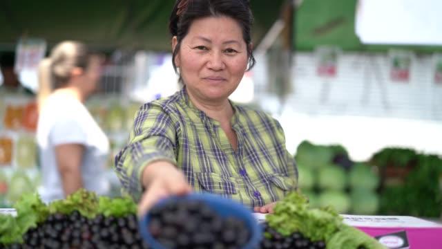 Japanese Ethnicity Woman Buying Jabuticaba / Jaboticaba on Farmers Market video