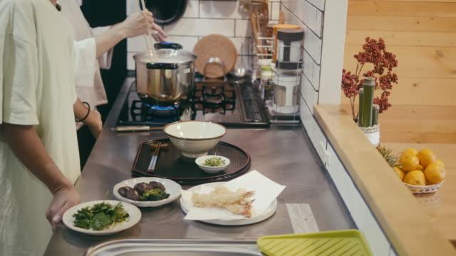 Japanese family making buckwheat soba noodles on New Years Eve