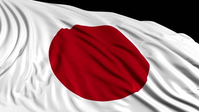 Japanese flag in slow motion. The flag develops smoothly in the wind
