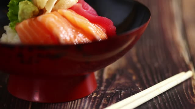 Japanese food: Mix sashimi and ebi served with Japanese cooked rice on table. Clean food concept.