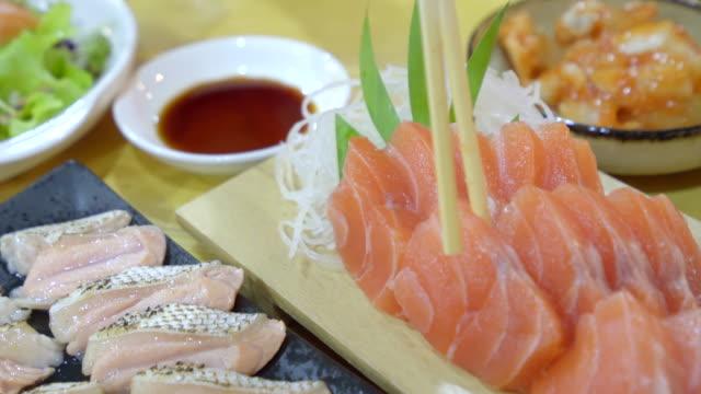 Japanese food sasimi set served on table Japanese food sasimi set served on table sashimi stock videos & royalty-free footage