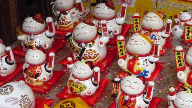 vidéos et rushes de chats japonais fortune (maneki-neko) - bonne chance