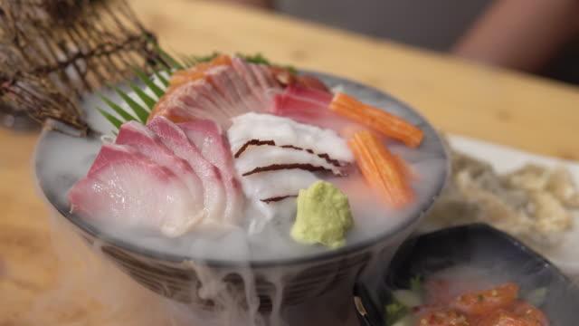 Japanese fresh sashimi fish and seafood set with dry ice.