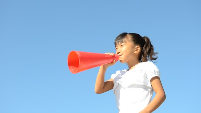 Japanese girl cheering with megaphone in the blue sky Japanese girl cheering with megaphone in the blue sky megaphone stock videos & royalty-free footage