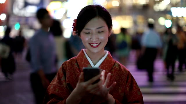 Japanese Girl in a Kimono Texting at the Shibuya Crossing video