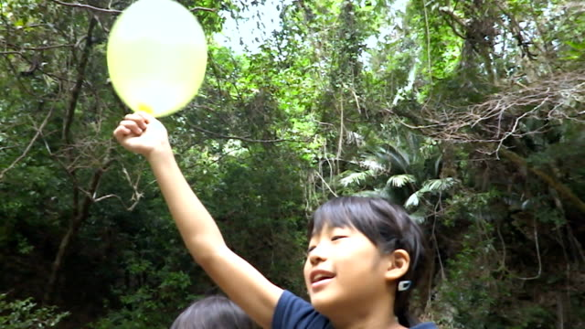 A Japanese girl playing with soap bubbles video