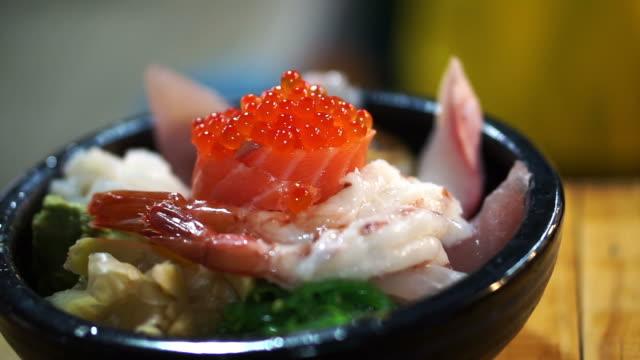 Japanese gourmet sashimi over rice bowl. Chirashi Assorted seafood Japanese gourmet sashimi over rice bowl. Chirashi Assorted seafood sashimi stock videos & royalty-free footage