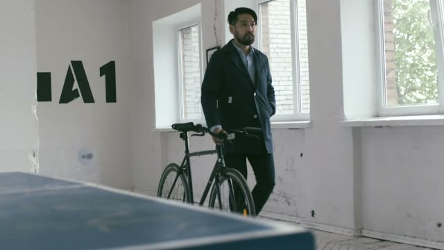 Japanese Graphic Designer coming to work with bike video