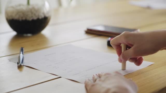 stockvideo's en b-roll-footage met japanse hanko signature stempel - stempel