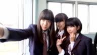 istock Japanese junior high school students taking selfie photography 1141121311
