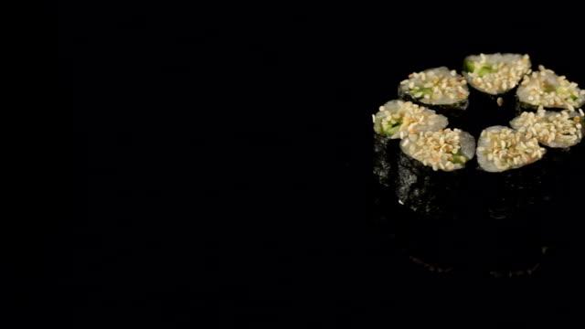 Japanese Maki rolls on a black background closeup. video