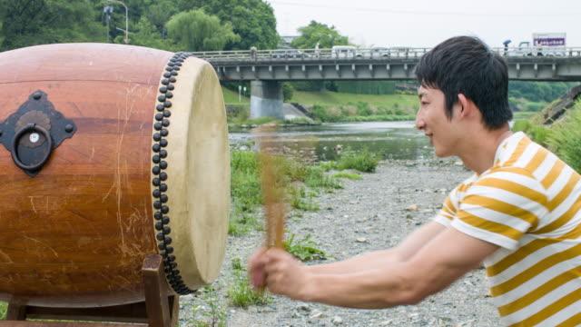 Japanese man playing Taiko drum video