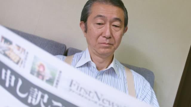 Japanese Man Reading Newspaper video