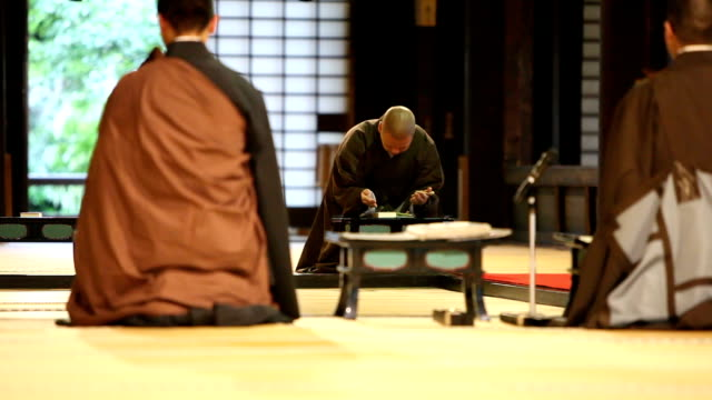 Japanese Monks Praying in a Buddhist Temple Three Japanese Monks praying and chanting inside a Buddhist Temple buddha stock videos & royalty-free footage