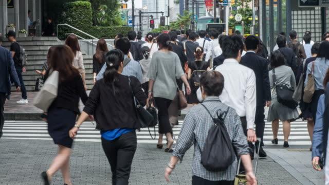 Japanese people commuting to work in Tokyo video