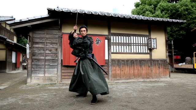Japanese Samurai with his sword held high A Japanese Samurai with his samurai sword ninja stock videos & royalty-free footage