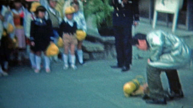 1972: Japanese school boys uniforms learning about safety. video