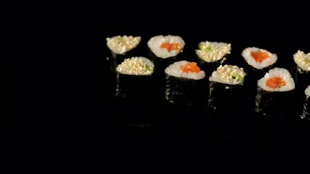 Japanese seafood sushi set on black background.