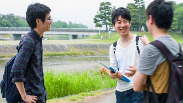 japanese students taking the bicycle back home from university - two students together asian video stock e b–roll