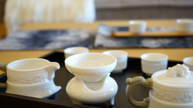 japanese style tea sets on end table in modern living room video