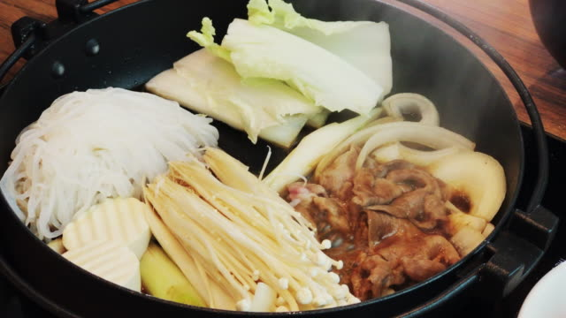 Japanese Sukiyaki with sliced pork and vegetable video