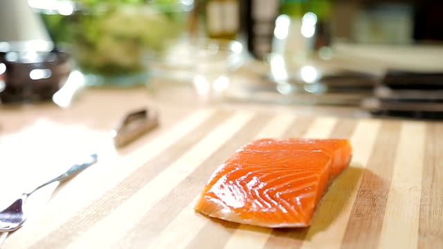 Japanese sushi chef carefully cutting salmon fish fillet, healthy seafood Japanese sushi chef carefully cutting salmon fish fillet, healthy seafood sashimi stock videos & royalty-free footage