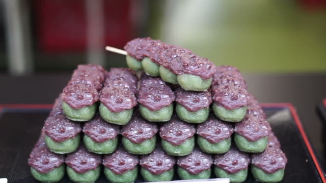 Japanese traditional dessert Dango, green tea with red bean and Mitarashi dango video