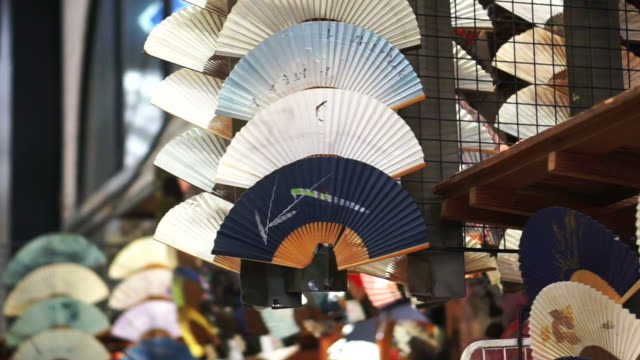 Japanese traditional hand fan, beautiful art and souvenir from Japan Japanese traditional hand fan, beautiful art and souvenir from Japan painting art product stock videos & royalty-free footage