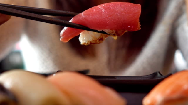 Japanese woman eating sushi video