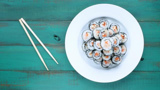 Japanese woman serve homemade Sushi maki gunkan roll plate video