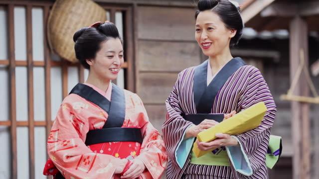 japanese women in traditional kimono at the village - costume tradizionale video stock e b–roll