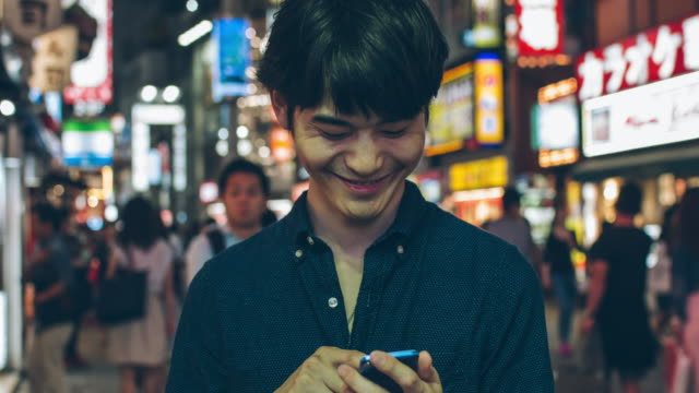 Japanese young man using mobile phone video