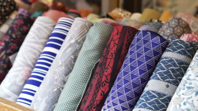 japanese yukata and kimono fashion fabric roll selling at shop in japan - rotolo video stock e b–roll