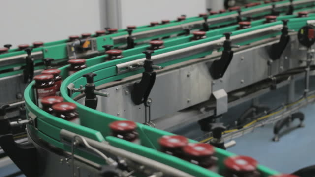 Jars on assembly line in Jam Factory, medium shot Beautiful shot of a Jam Factory. The Assembly line. jar stock videos & royalty-free footage