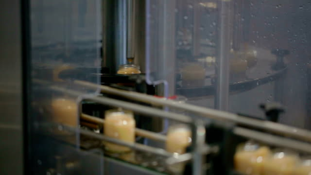 Jars with mash move on wide conveyor belt at factory video