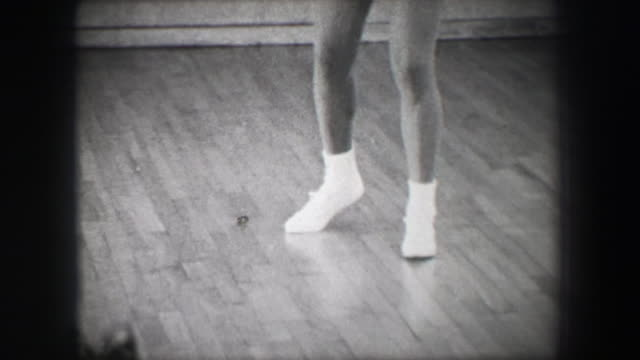 1966: Jazz dance moves 1 closeup behind kick stepping shuffle slide. video