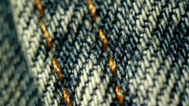 jeans close up macro - cucitura video stock e b–roll