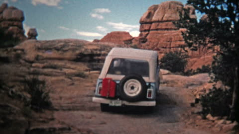 1971: Jeep driver bouldering up a steep incline offroad trail. . advertisement stock videos & royalty-free footage