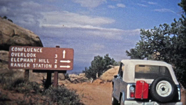 CANYONLANDS, UTAH -1971: Jeep offroad driving to the Confluence Canyon Overlook.