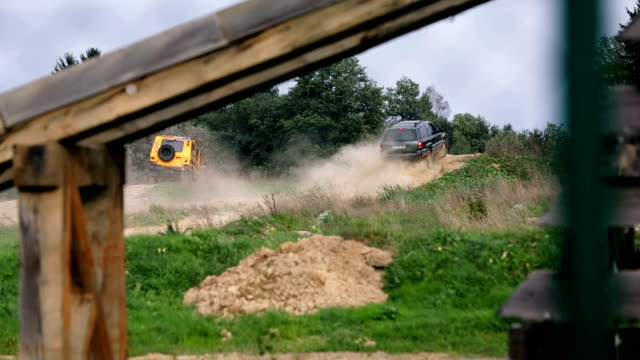 HD: Jeep stops in distance at peak of racing polygon video