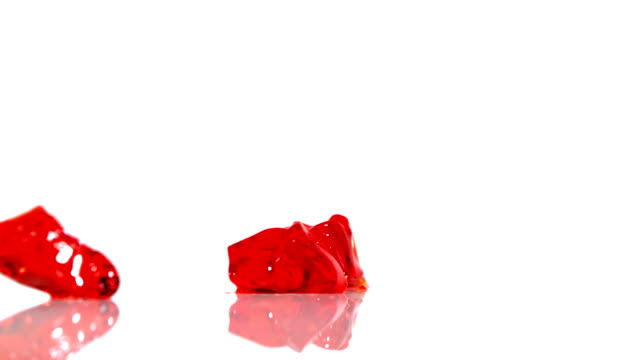 Jello falling on the floor and bouncing, Slow Motion Jello falling and bouncing shooting with high speed camera. jello stock videos & royalty-free footage