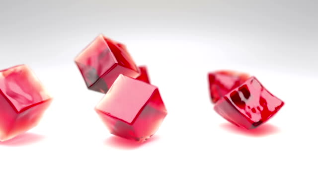 Jelly cubes falling Falling jelly cubes with depth of field jello stock videos & royalty-free footage