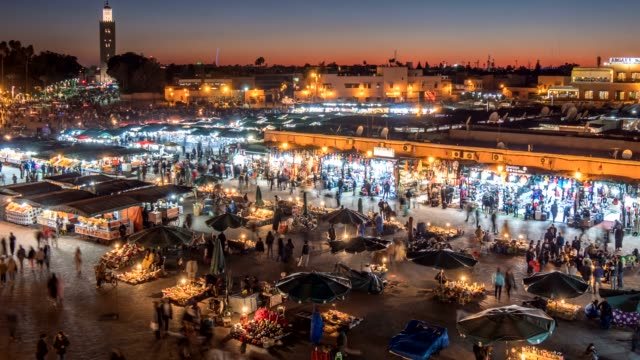 Jemaa el-Fnaa (Jamaa el Fna) square and market place in Marrakesh's medina quarter (old city), Morocco. Time lapse after sunset