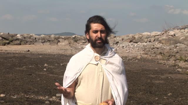 Jesus / Disciple breaking bread at Communion video