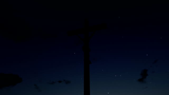 Jesus on Cross, camera fly, timelapse sunrise, night to day video