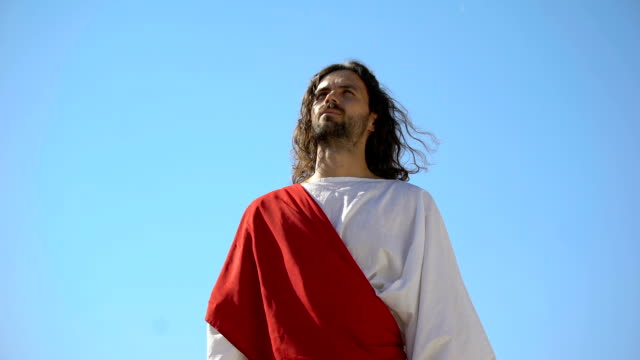 Jesus raising hands to sky and praying, resurrection and ascension of Christ
