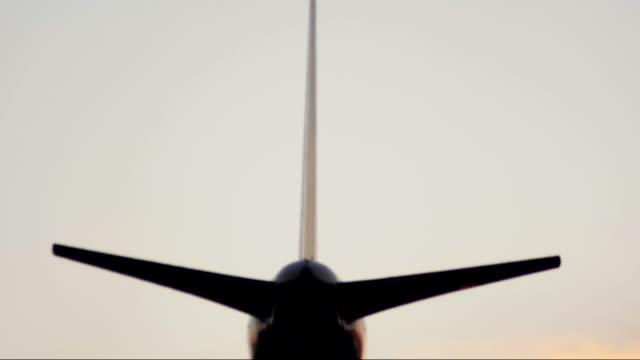 Jet airliner landing during sunset. video